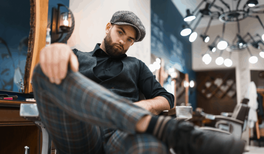 barber in professional menswear sitting on a chair