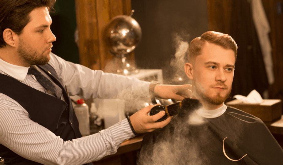 well dressed barber using a neck duster