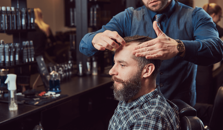 licensed barber cutting hair in the barbershop