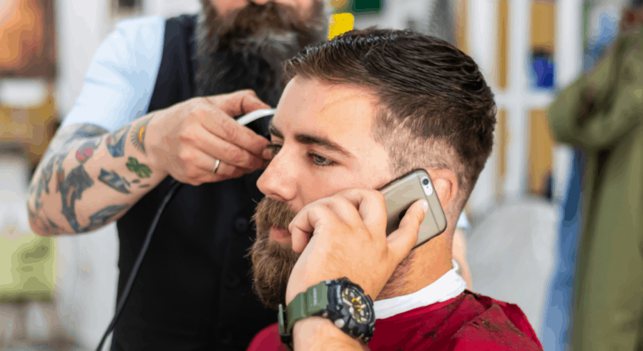 guy talking on the phone in the barberchair