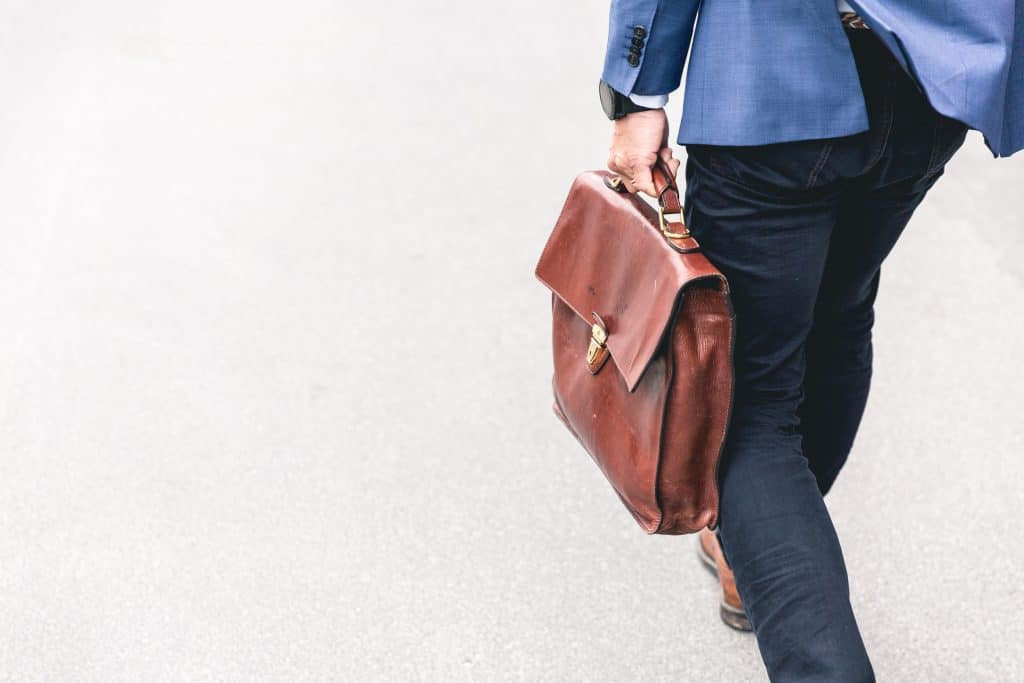 man walking with a brief case