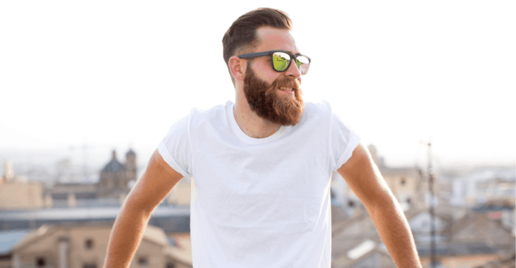 man leaning on a rail with a full thick beard