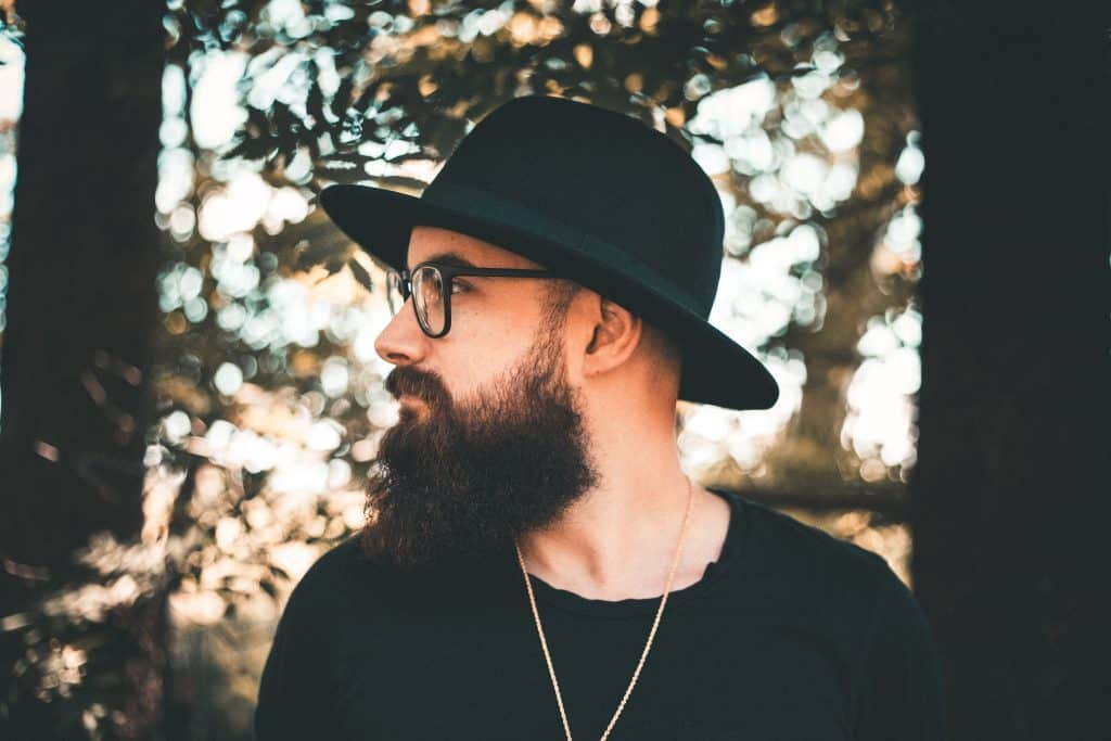 man with a hat and thick beard