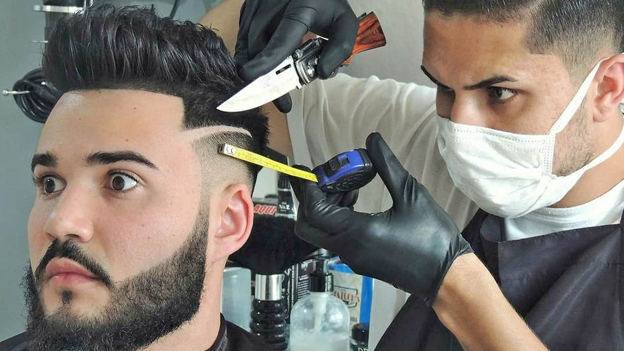 barber cutting a fade with a knife and tape measure being funny