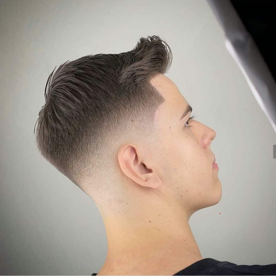 Mid skin fade image using a high quality camera at the barbershop