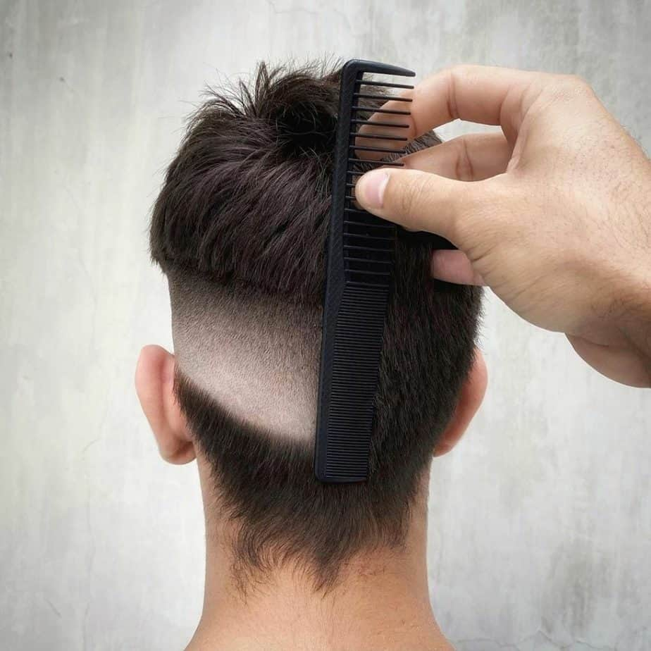 a haircut thats half faded and the other half is uncut showing the skill of the barber