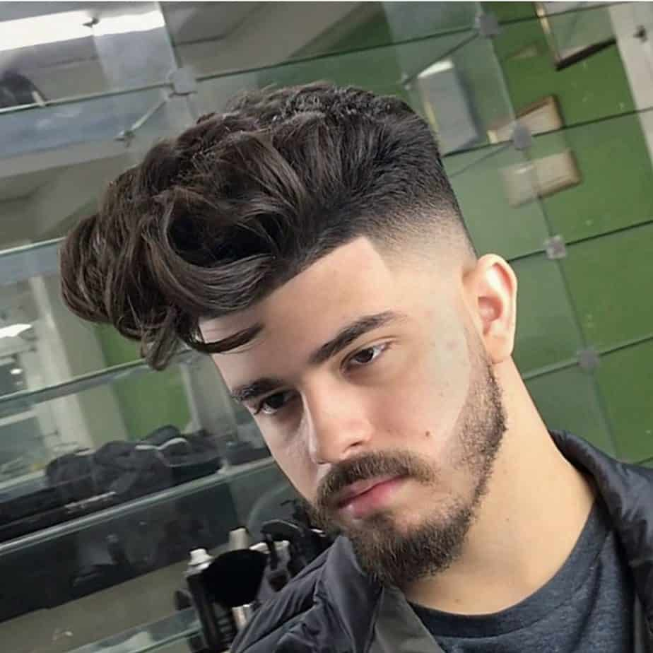 High skin fade haircut with a pompadour finish on top