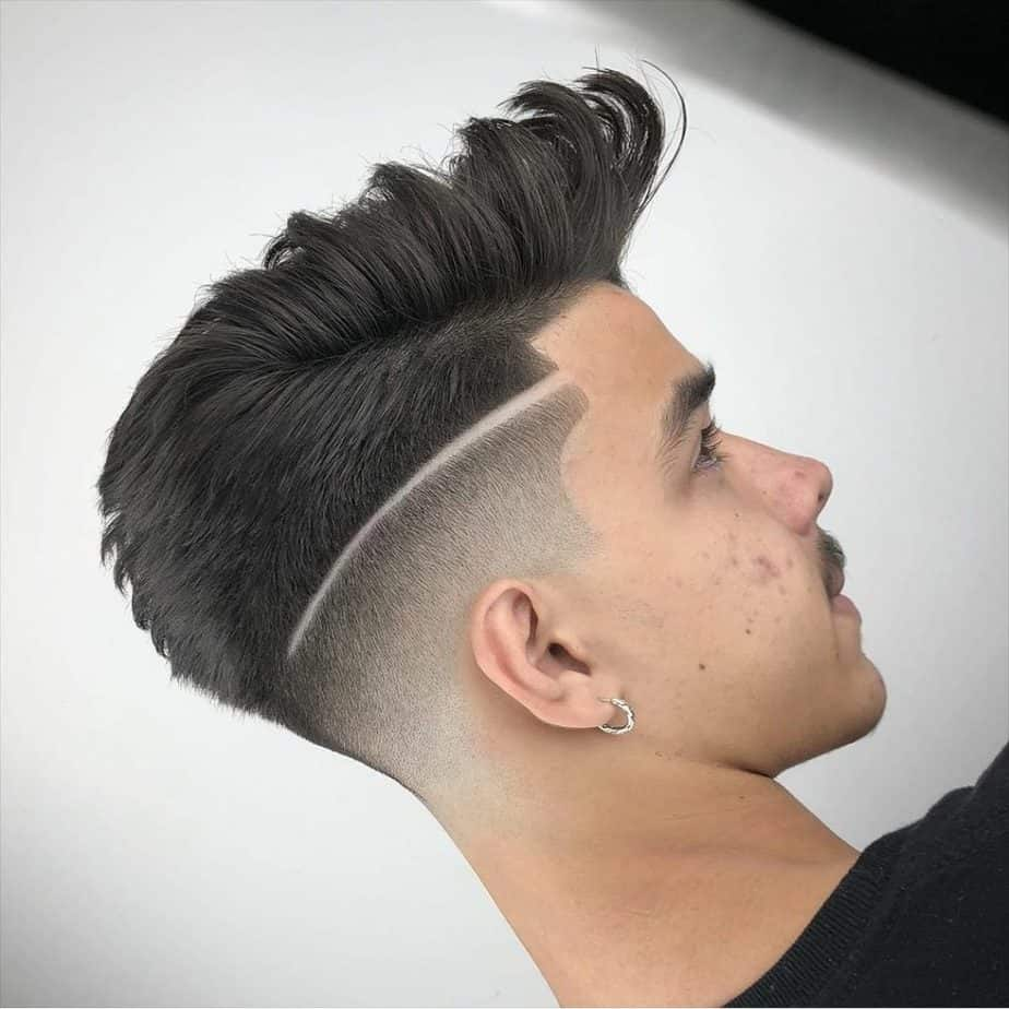 Fad haircut with a pompadour top and line in the side of the haircut