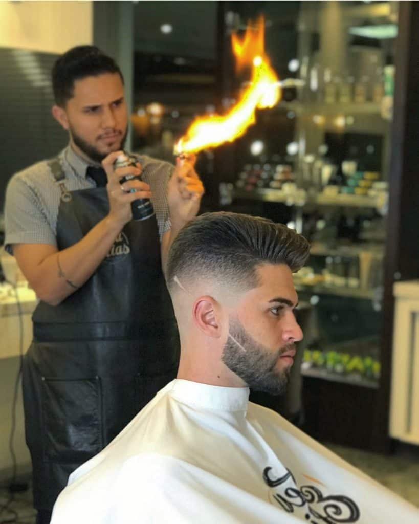 fade haircut with igor making fire in the background for extra drama