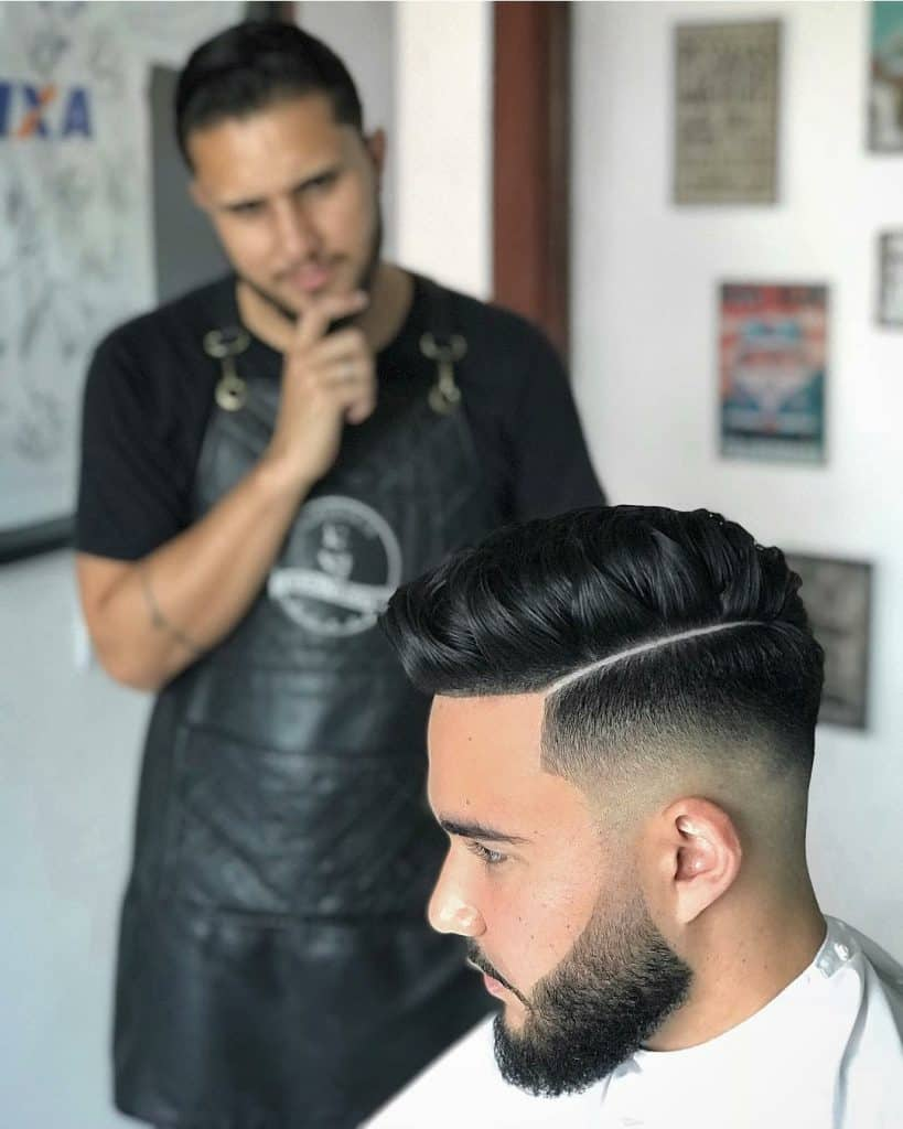 high fade haircut with igor the barber making a funny thinking face behind the client