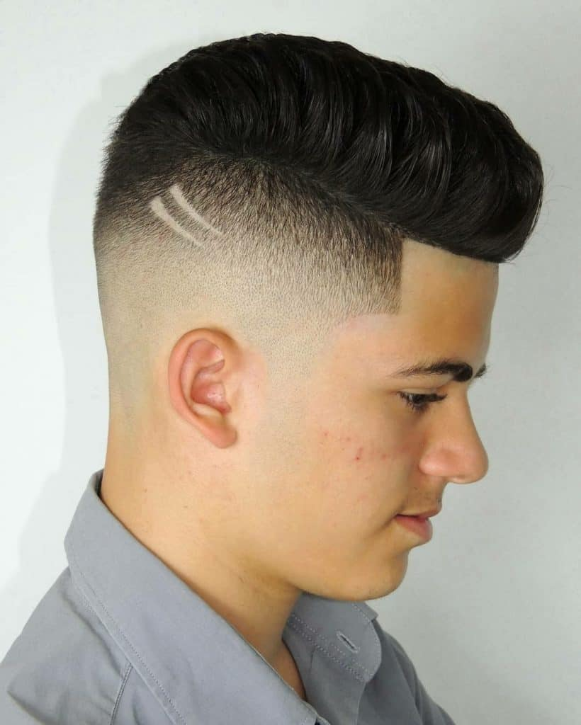 high skin fade hair with two small cut designs to add artistry