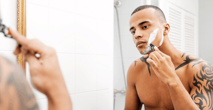 guy getting a great shave in his bathroom