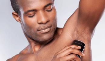 black man putting on organic deodorant