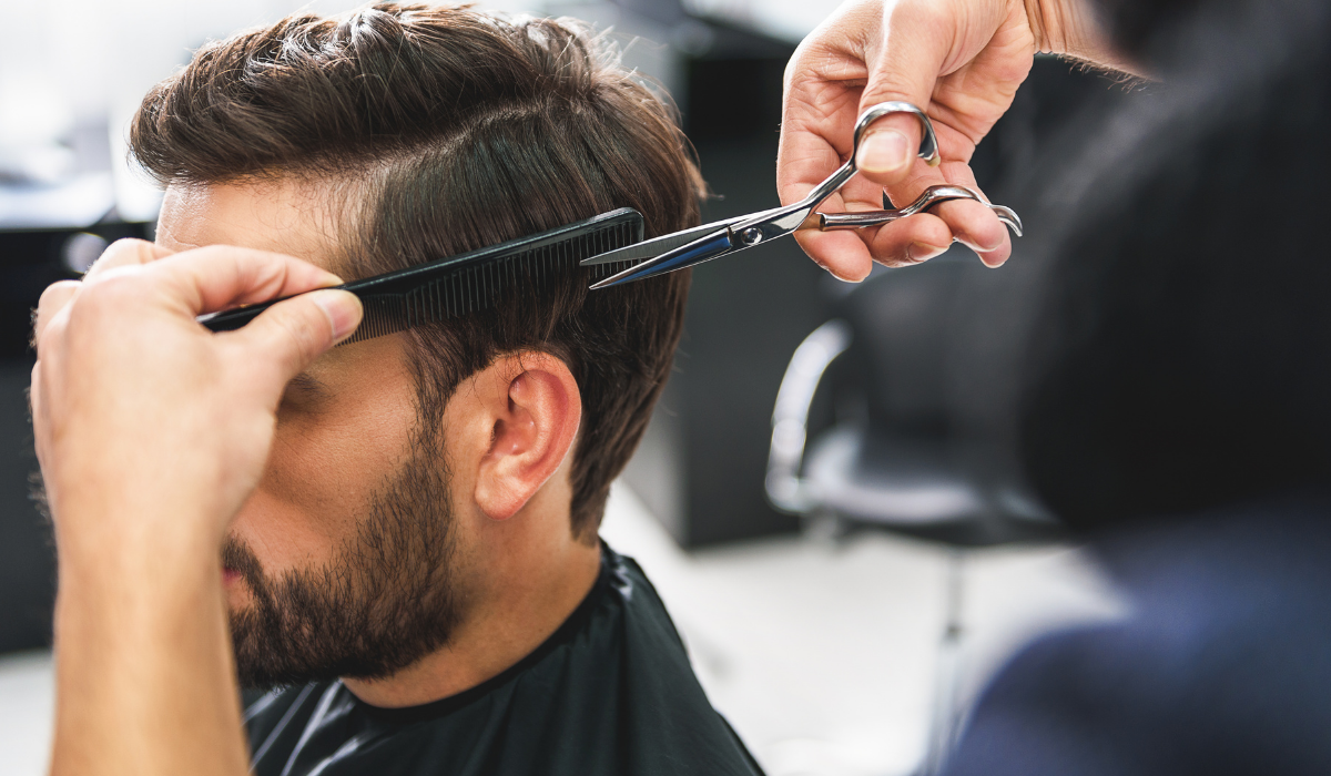 image of barber cutting hair
