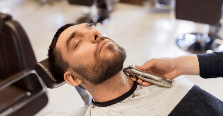 Barber using a gtx blade on his trimmers
