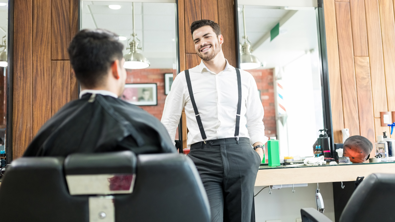 image of a barber talking to his client