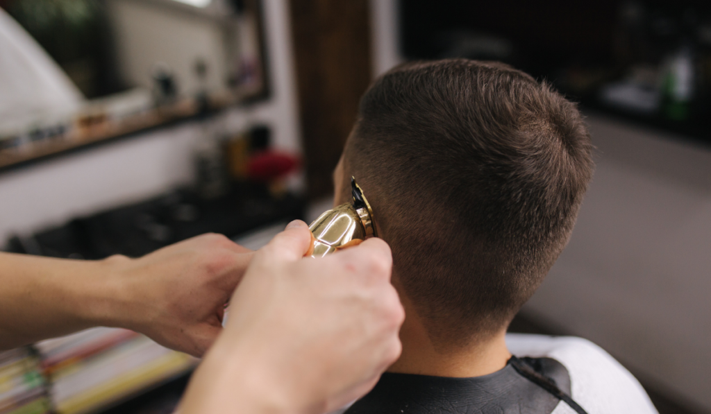 image showing how to use the trimmers to cut around the ear.