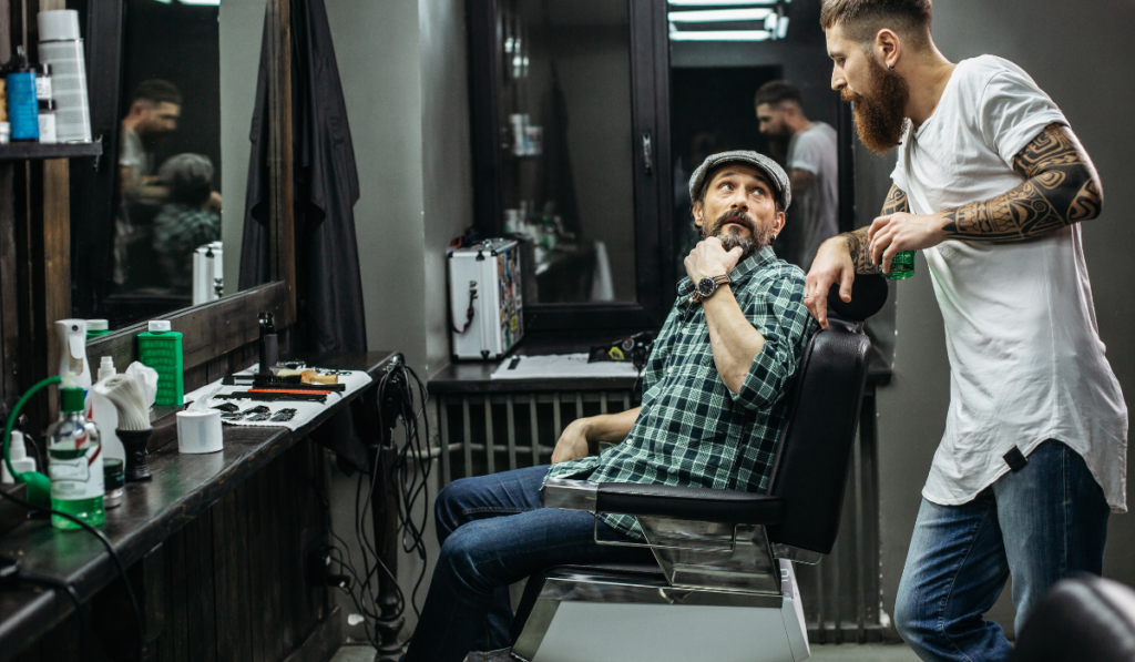 image of a barber talking to his client in the barbershop