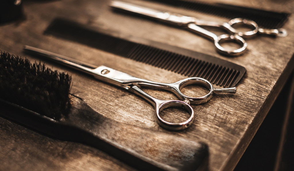 haircutting tools laying on a table.
