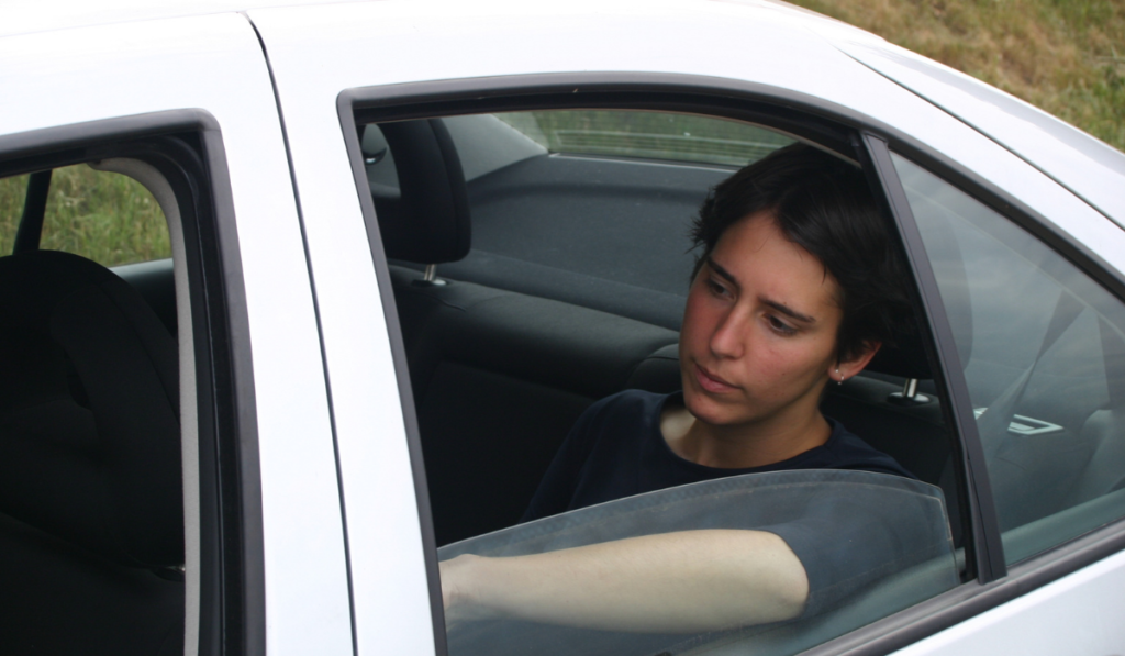 image of a person sitting in the backseat
