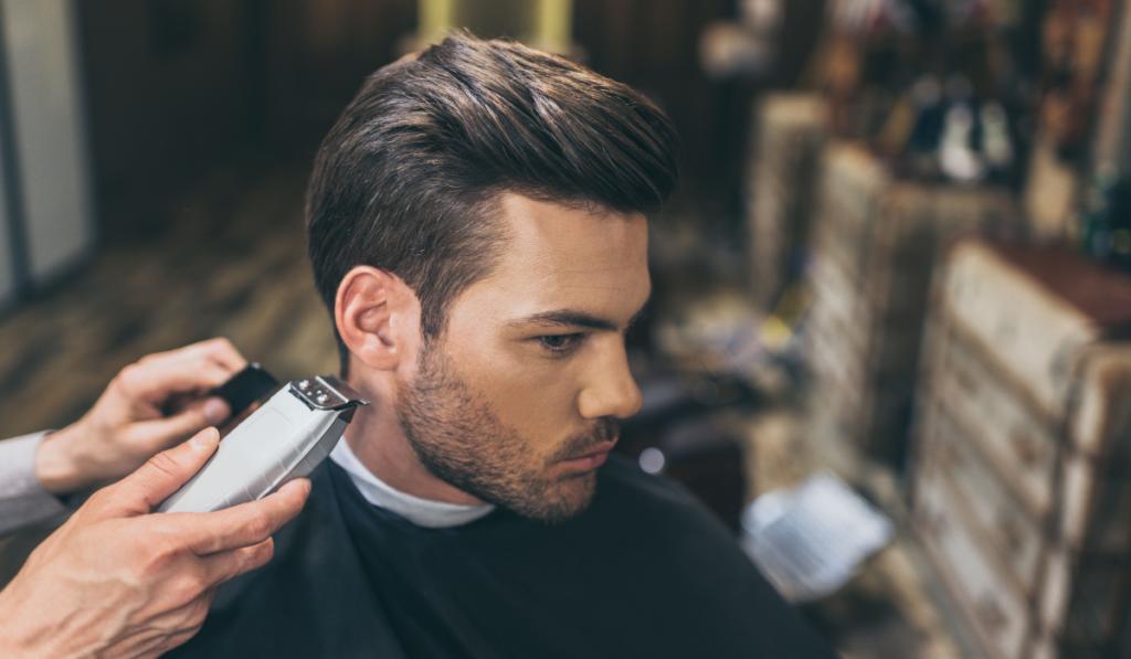 image of a barber cutting hair